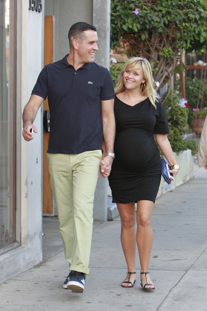 Pregnant Reese Witherspoon held hands with her husband.