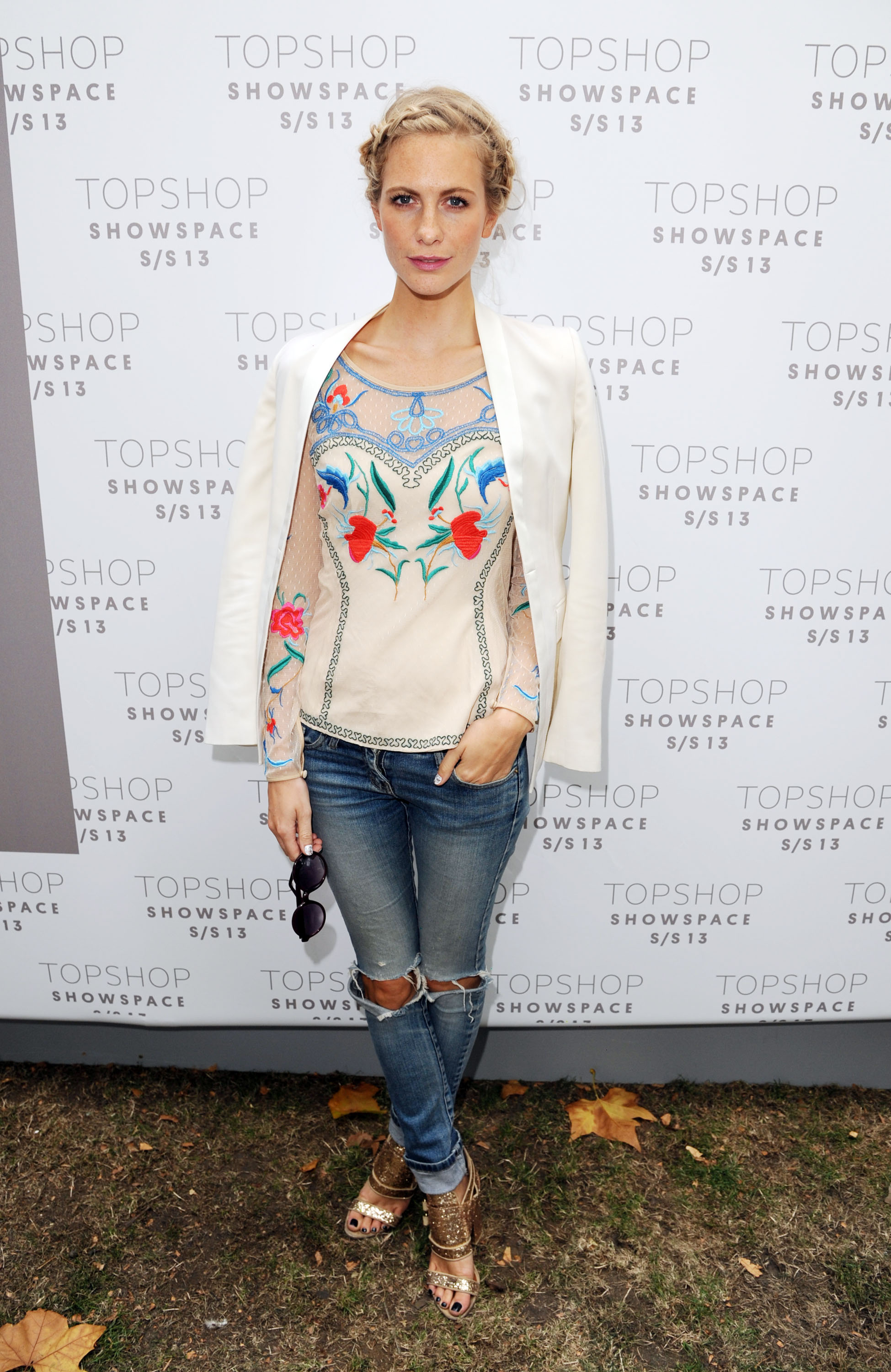 Poppy Delevingne paired an embroidered top with a sleek white blazer at Unique in London.