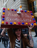 A girl held up a faux cake in New York in honor of Occupy Wall Street's one-year anniversary.