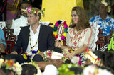 Prince William wore a head piece while Kate Middleton donned a traditional dress during their visit to Tuvalu.