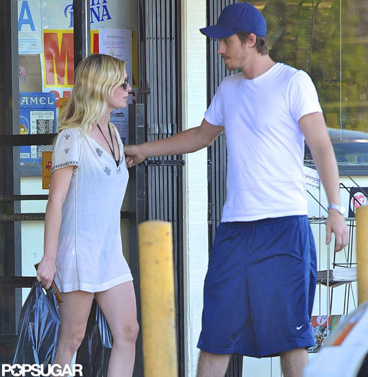 Garrett Hedlund held the door during an outing with girlfriend Kirsten Dunst.