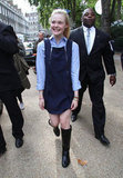 Elle Fanning smiled at Fashion Week.