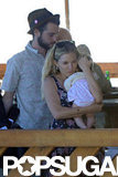 Sienna Miller held baby Marlowe tight with Tom Sturridge close by on their boat ride.