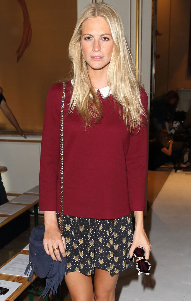 Poppy Delevingne's pretty white collar contrasted a warm, cranberry knit and complemented the sweetness of her printed skirt.