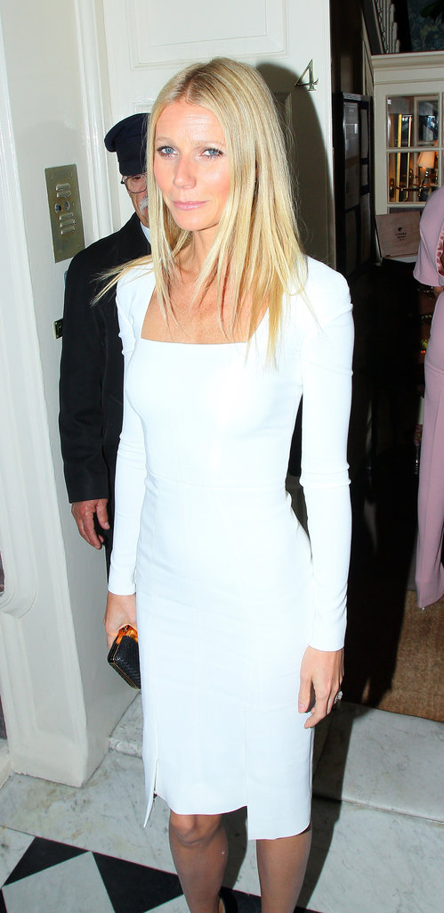 Gwyneth Paltrow showed off her fit physique in a tight-fitting Tom Ford dress for a dinner party in London.