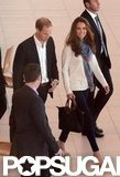Kate Middleton wore a scarf and sweater with jeans to travel with Prince William who wore a casual suit without a tie.