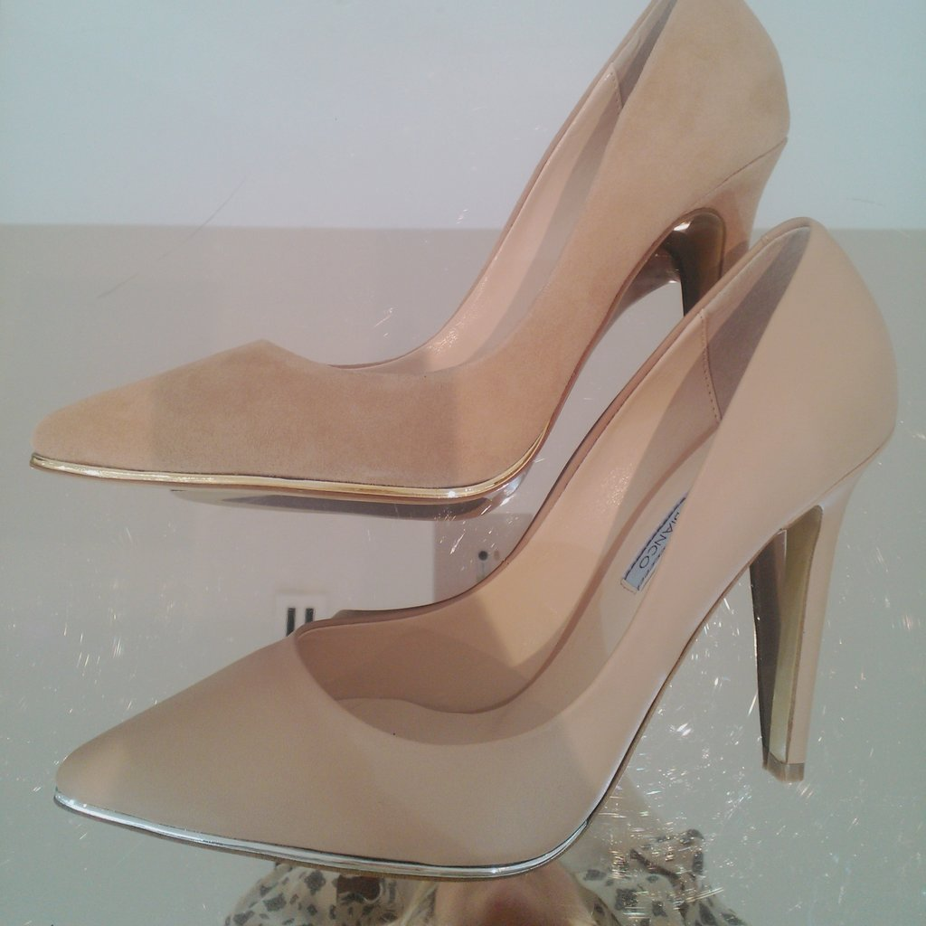 Sneaky peek: gold and silver edging gives luxe appeal to the classic nude pointy-pump. In-stores Oct.