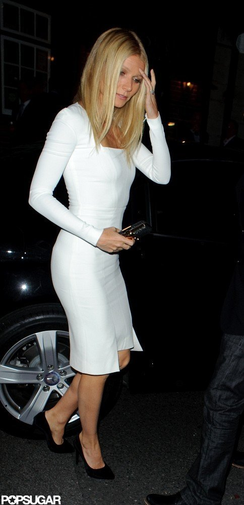 Gwyneth Paltrow showed off her figure in a tight white Tom Ford dress for a dinner party in London.