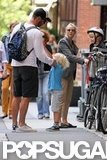 Liev Schreiber and Naomi Watts put helmets on their boys for a bike ride around the Big Apple.