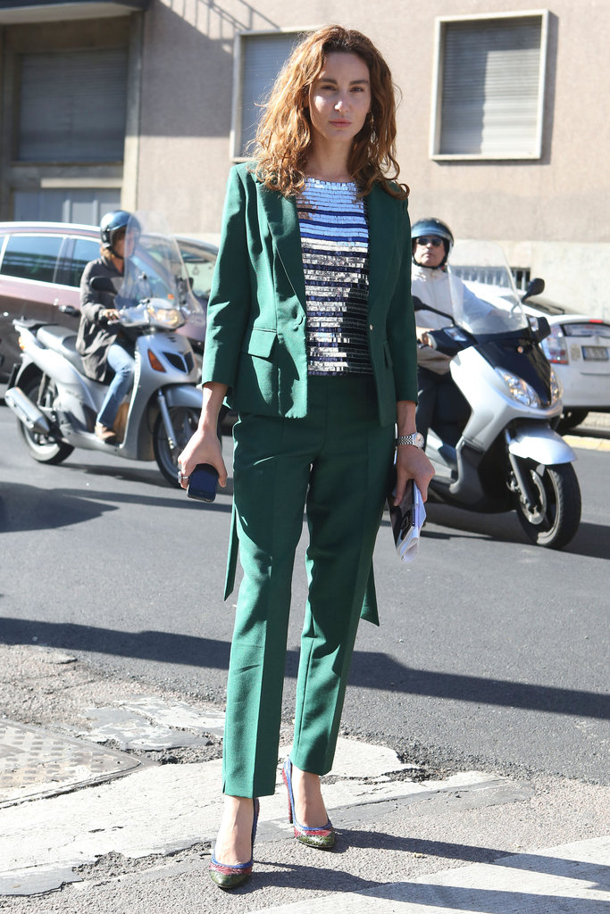 Classic suiting in an unexpected flash of green felt totally fresh on the streets of Milan.