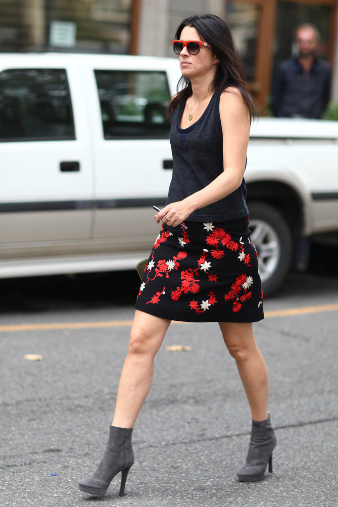 A modern take on a vintage-feeling skirt, thanks to a slouchy tee, platform ankle boots, and bright shades. Source: Greg Kessler