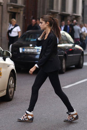We love the way her cool-girl kicks played off a sophisticated blazer. Source: Greg Kessler