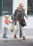 Naomi Watts held hands with her boys while waving down a cab.