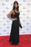 Supermodel Iman looked simply elegant in a black ruffle-back gown.