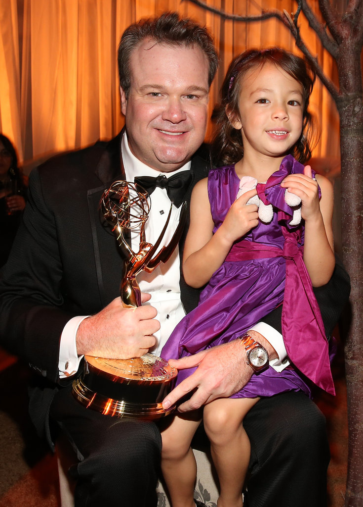 Modern Family's Eric Stonestreet held up his onscreen daughter at the Fox party.