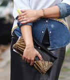 This styler worked an embellished leather clutch into her denim-and-leather look. Source: IMAXtree