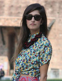 This beaded necklace lent a little tribal-cool to a floral blouse and classic Ray-Bans. Source: IMAXtree