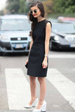 This classic LBD gets its mod appeal via thick white heels. Source: Greg Kessler