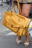 This Proenza let a little bright yellow and a whole lot of luxe to this street-style moment. Source: Greg Kessler