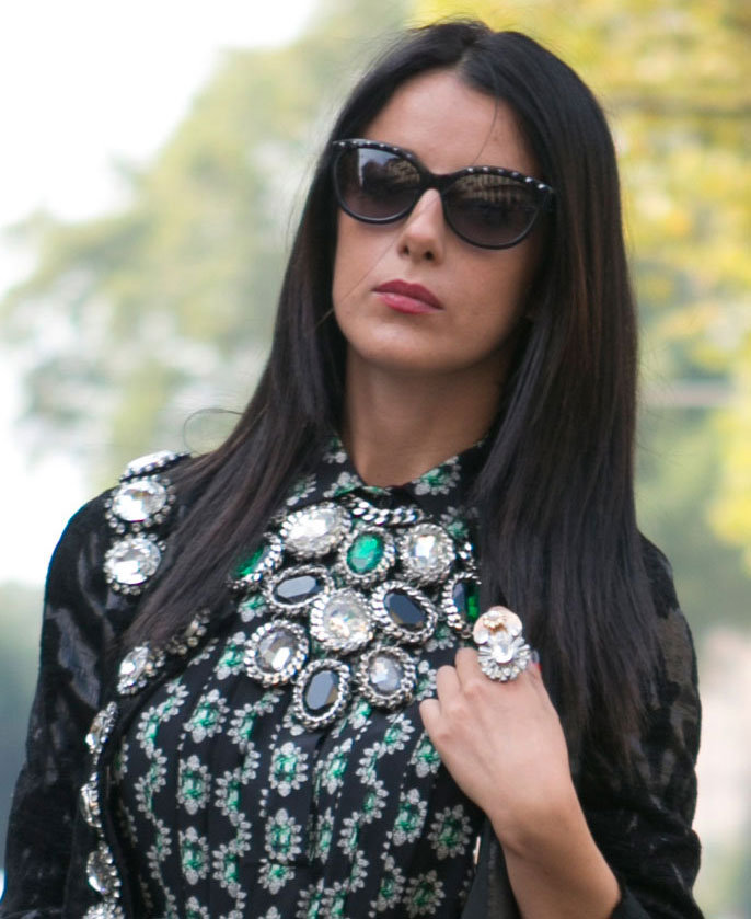 Emerald jewels and a major cocktail ring caught our attention on this look. Source: IMAXtree