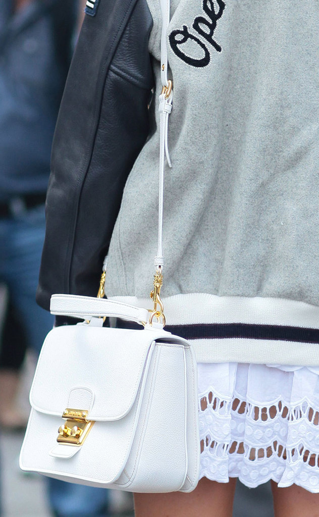 This white bag was a crisp, classic complement to a varsity jacket and lace skirt. Source: Greg Kessler