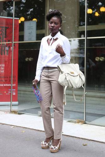A riff on the classics via a white button-down with a cutout neckline and a pair of understated trousers.