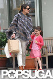 Suri Cruise chatted while she strolled with Katie Holmes.