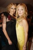 Kate Hudson and Charlize Theron got together during the Christian Dior presentation in July 2007.