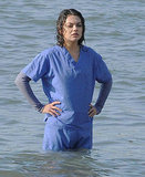 Mila Kunis stood in the water between takes.