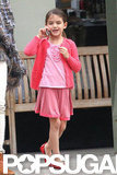 Suri Cruise chatted on her iPhone.