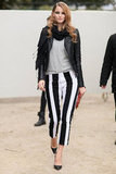 A master class in graphic black and white, this model mixed vertically striped trousers with a hot pair of d'orsay heels.