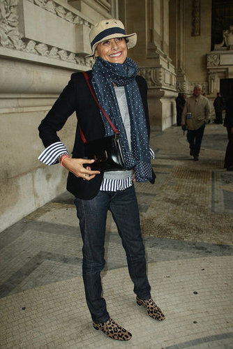 Inès de la Fressange paired a bevy of prints at Carven, but it totally worked. Between the stripes on her blazer cuffs and the leopard-printed boots, we're convinced this is a look we could pull off, too.