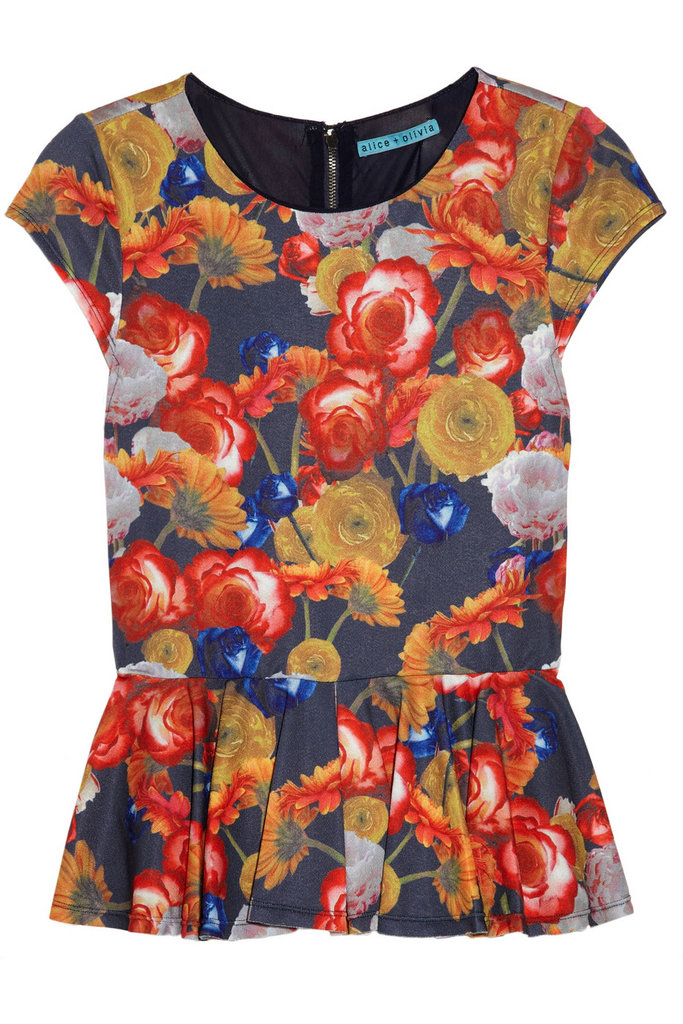 Wear florals into Fall with this peplum top. Its darker, slightly moody color palette keeps things seasonally appropriate, while the flare at the hip keeps it universally flattering.  Alice + Olivia Floral-Print Stretch-Jersey Peplum Top ($220)