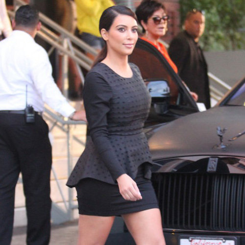 Kim Kardashian Wearing Black Peplum Top