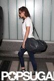 Kristen Stewart carried a bag over one shoulder at LAX.