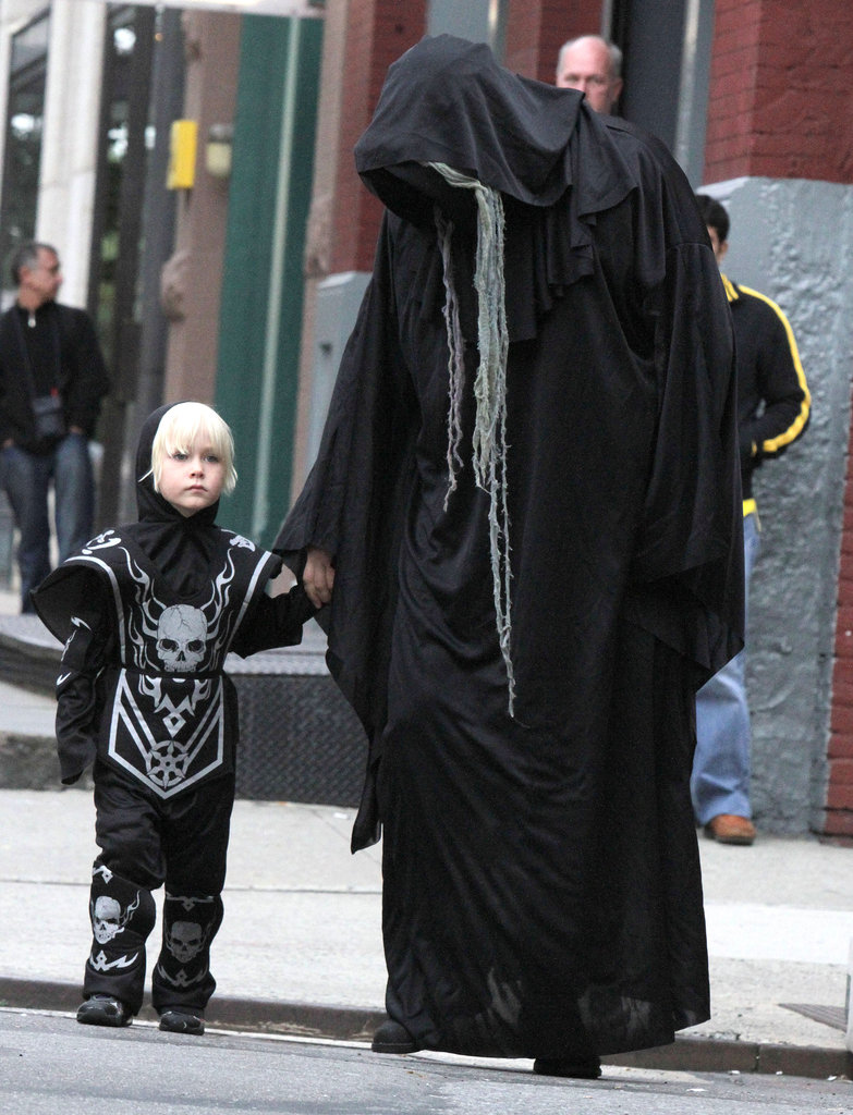 Liev Schreiber and his son got into the spirit while out in NYC in 2011.