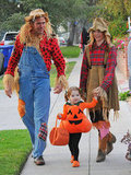Alyson Hannigan and her husband, Alexis Denisof, got into the spirit as scarecrows with their daughter as a pumpkin in LA in 2011.