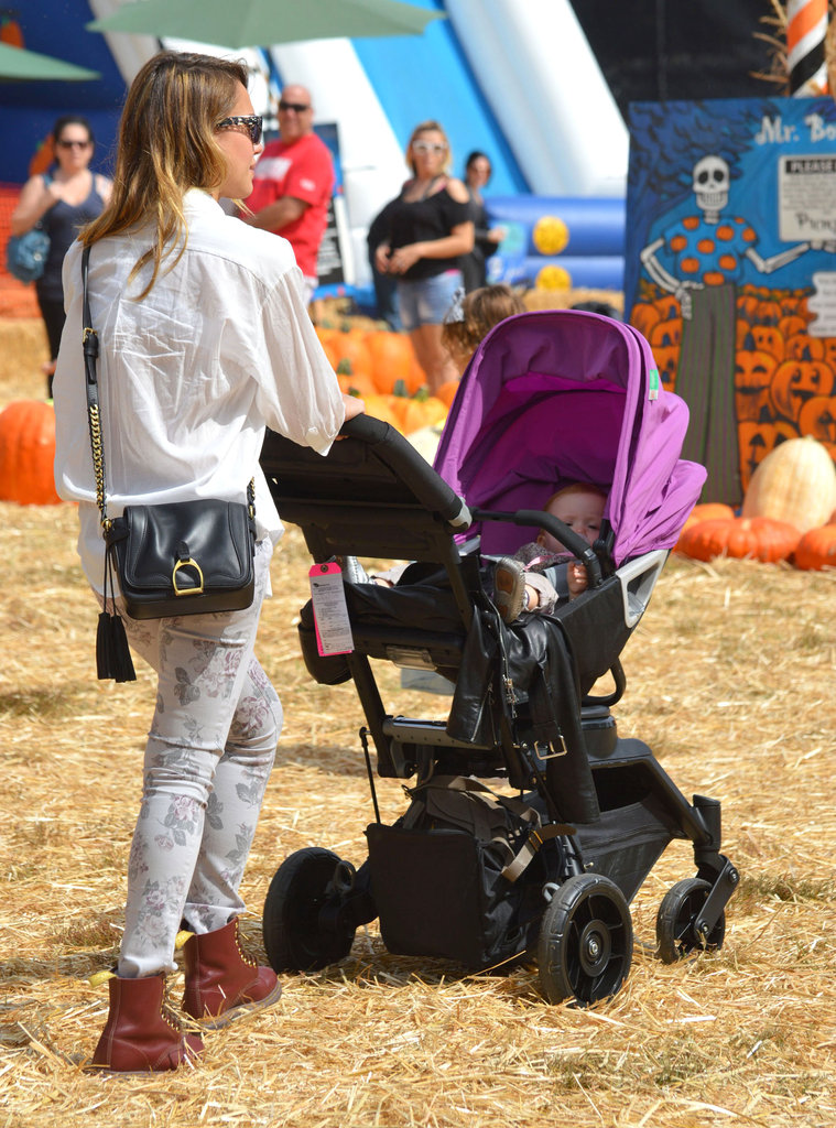 Jessica Alba pushed Haven Warren through a pumpkin patch.