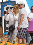 Jessica Alba and Cash Warren watched over their girls during a trip to the pumpkin patch.