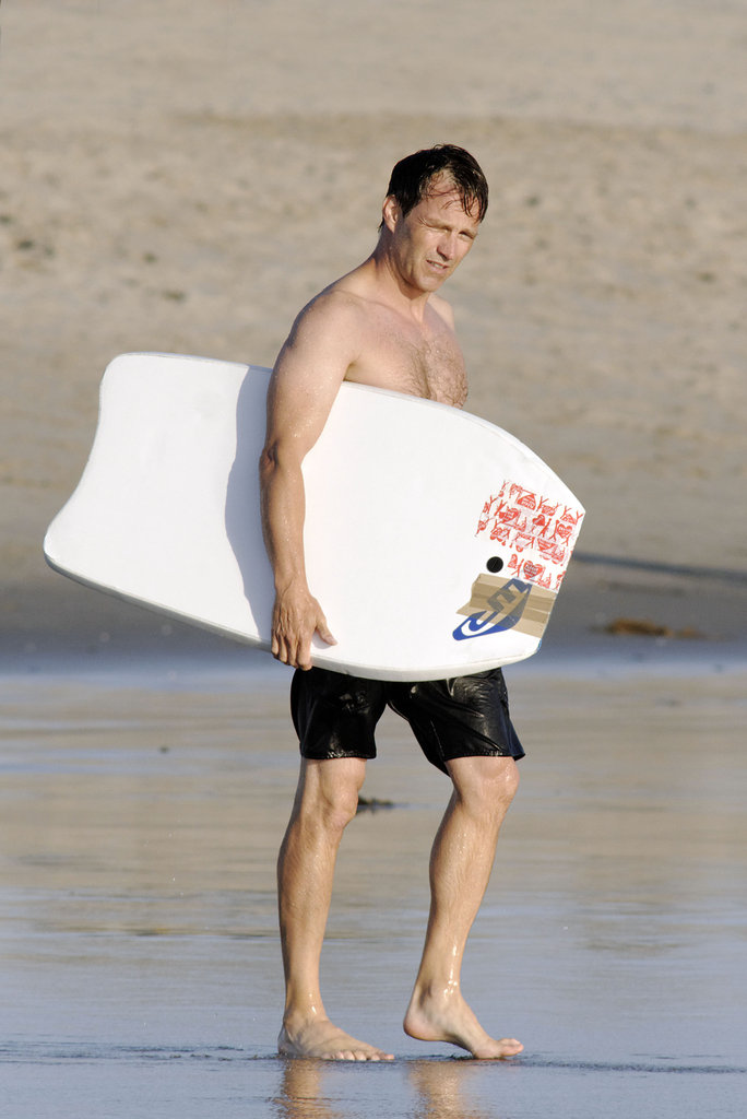 Stephen Moyer walked on the beach.
