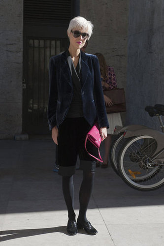 A tomboy look emboldened with a pop of color on her clutch and velvet on her blazer.
