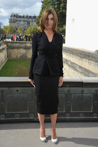 Carine Roitfeld accented her signature all-black uniform with white pumps at Christian Dior.