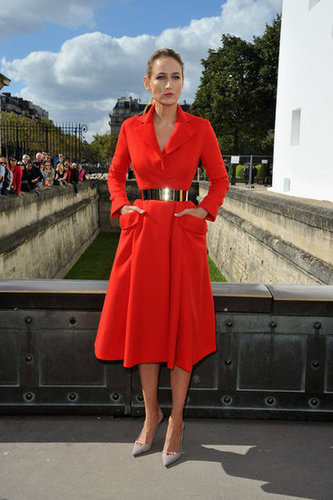 Leelee Sobieski opted for something a bit dramatic for her appearance at the Christian Dior show, wearing a bright red trench coat-turned-dress with a high-shine waist belt.