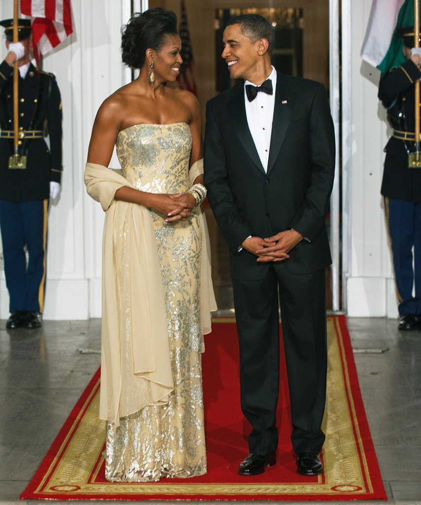 Barack and Michelle enjoyed a moment together before welcoming the Indian president and his wife to the White House.