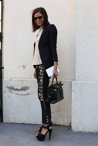 Embroidered trousers have a cool effect on a lace top and blazer.
