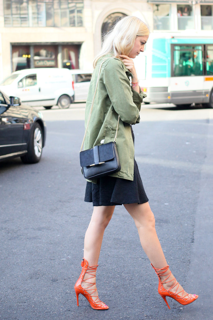 Proof that a great anorak goes with practically anything — here it tempered a ladylike dress and fiery lace-up heels.