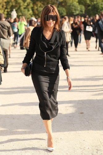 Carine Roitfeld made a sleek arrival, per usual, in a fitted pencil skirt and visor-style sunglasses.