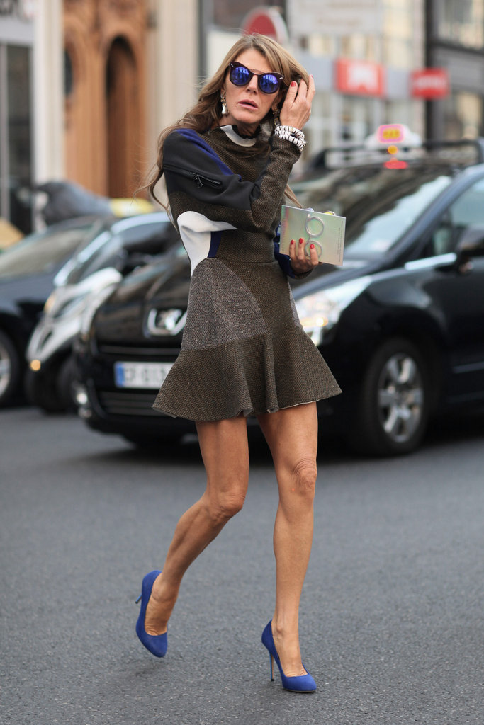 Anna Dello Russo worked a fluted mini and matched her mirrored shades with her pumps.