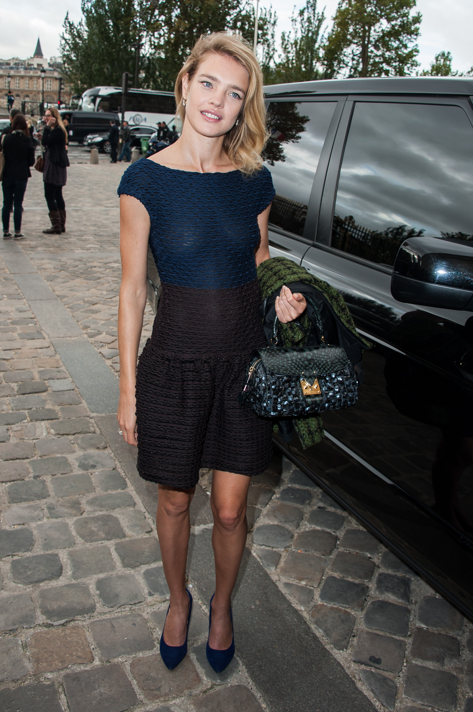 Natalia Vodianova went with a ruffled-hem dress in a cool two-toned palette at Louis Vuitton.