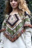 This embroidered capelet could shape even the most basic tops into a standout look with its bohemian embellishments.